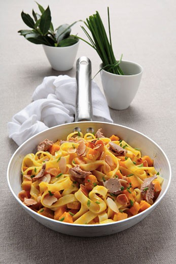 Ribbon pasta with pumpkin and foie gras : Stock Photo