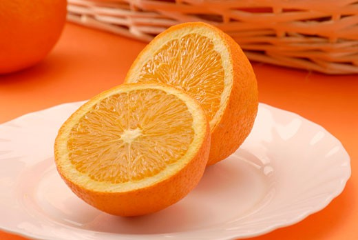 Two orange halves on plate : Stock Photo