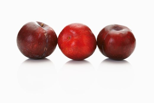 Stock Photo: 1532R-51439 Three red plums