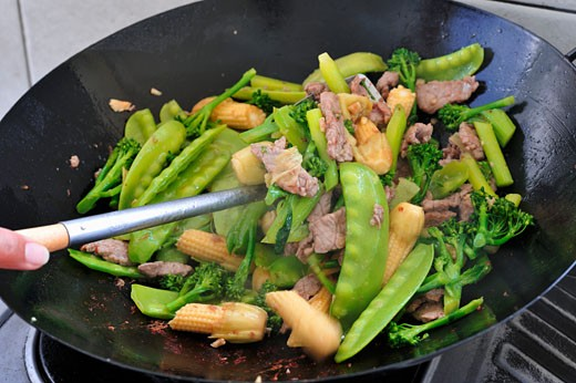Stir-fried beef and mangetout with soy sauce : Stock Photo