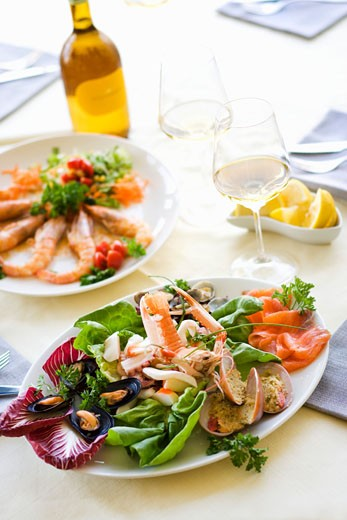 Plate of assorted seafood appetisers : Stock Photo
