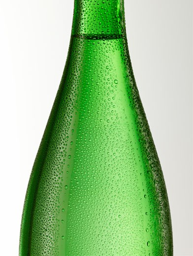 Green glass bottle with condensation (detail) : Stock Photo