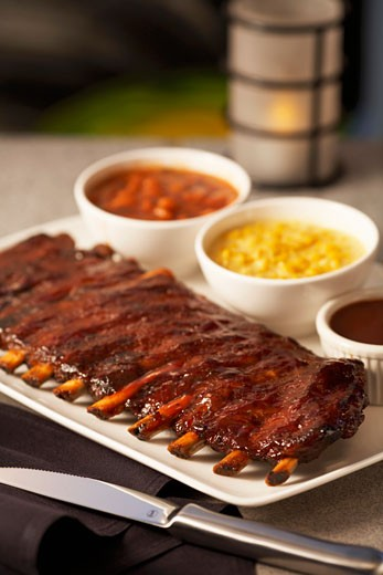 Spare Ribs with Baked Beans and Creamed Corn : Stock Photo