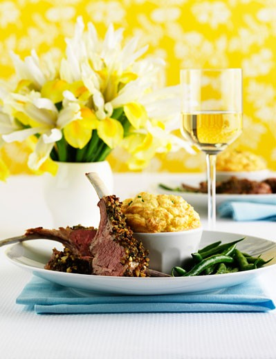 Lamb chops with cheese soufflé and beans : Stock Photo