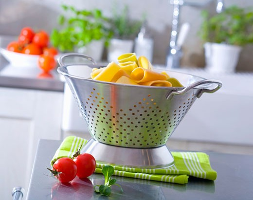Cooked pasta in a colander : Stock Photo