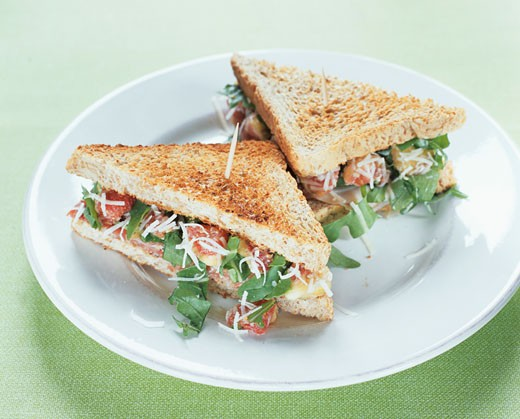 Fig, rocket & Parmesan sandwiches made with wholemeal toast : Stock Photo
