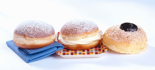 Three doughnuts with plum jelly, vanilla cream and jam : Stock Photo