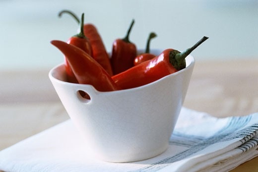 Red chillies in a white dish : Stock Photo
