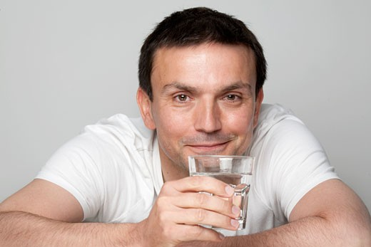Man holding glass of water : Stock Photo