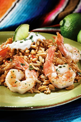 Stock Photo: 1532R-54740 Shrimp Over Rice with Lime Garnish