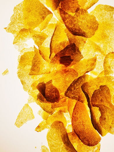 Potato crisps, backlight : Stock Photo