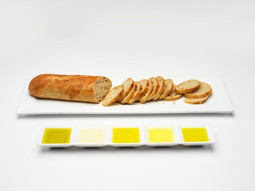 Baguette and various types of olive oil for tasting : Stock Photo