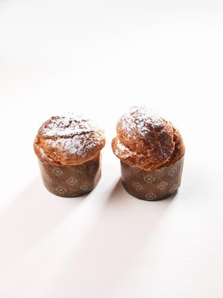 Brioche muffins in paper cases : Stock Photo