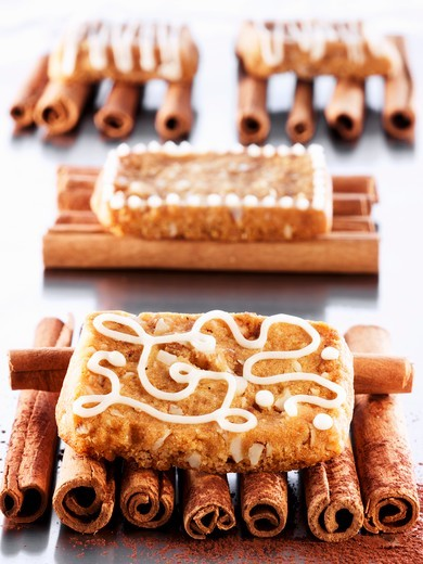 French 'pepper nut' biscuits on cinnamon sticks : Stock Photo