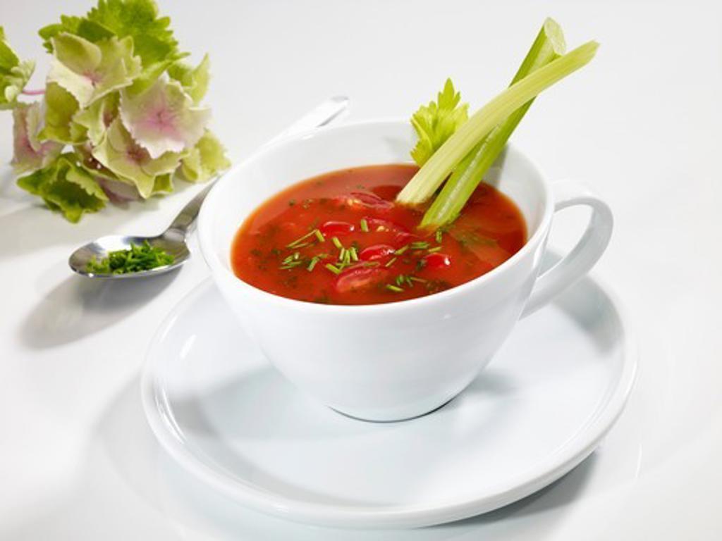 Stock Photo: 1532R-57453 Tomato soup with celery sticks