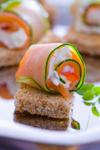 Courgette and salmon rolls with goats cheese on bread : Stock Photo
