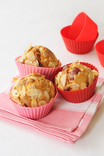 Cranberry muffins with slivered almonds : Stock Photo