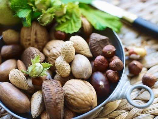 Various nuts in a metal bowl : Stock Photo