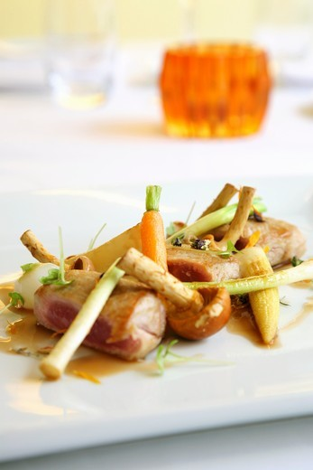 Pork fillet with roasted baby vegetables : Stock Photo