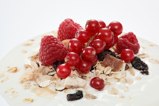 Stock Photo: 1532R-59048 Berry muesli on a dollop of yogurt (close-up)