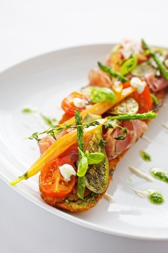 Baguette with ham, grilled vegetables and pesto : Stock Photo