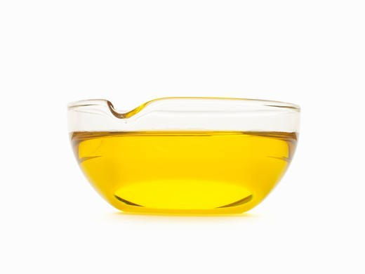 Bowl of Oil; White Background : Stock Photo