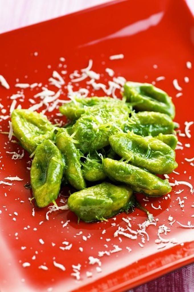 Gnocchi with pesto and pecorino cheese : Stock Photo