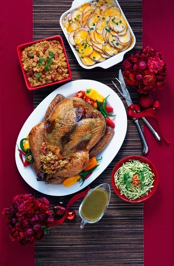 Stock Photo: 1532R-60492 Tex-Mex style roast turkey and side dishes (viewed from above)