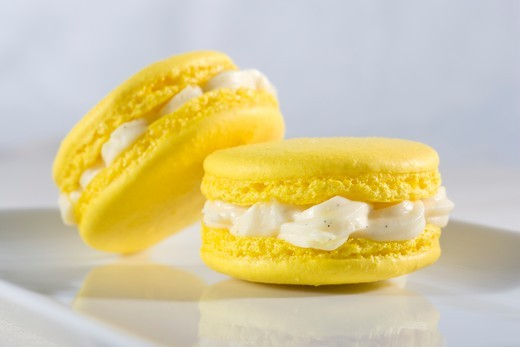 Two macaroons with vanilla cream : Stock Photo