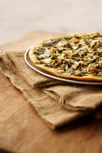 Stock Photo: 1532R-61213 Thin Crust Pizza Topped with Chicken, Mushrooms, Onions and Pesto
