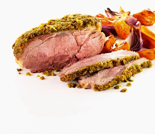 Roast lamb with pesto chili crust : Stock Photo