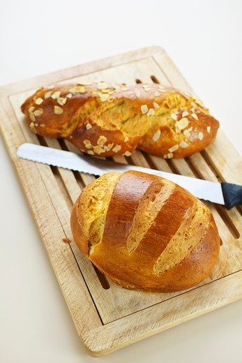 Two types of brioche on a wooden board : Stock Photo
