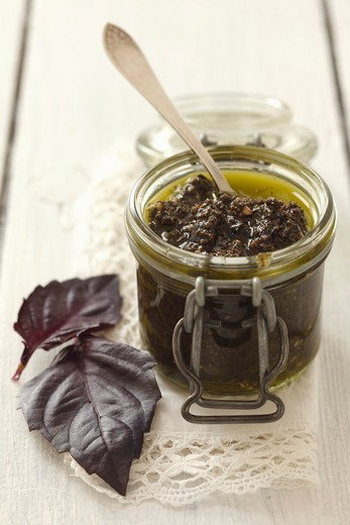 A jar of purple basil pesto : Stock Photo
