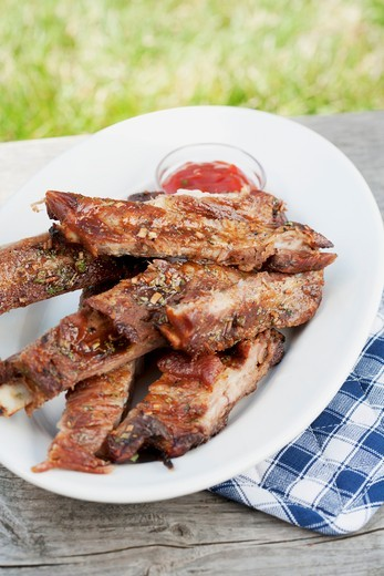 Grilled spare ribs and barbecue sauce : Stock Photo