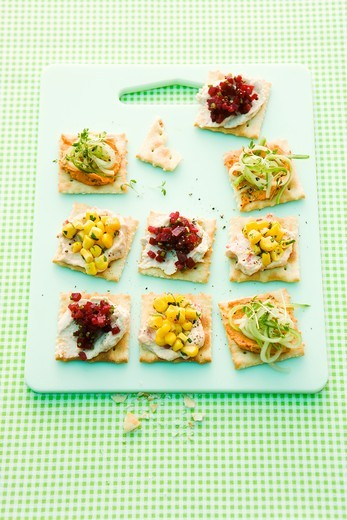 Party crackers topped with cucumber, beetroot and sweetcorn : Stock Photo