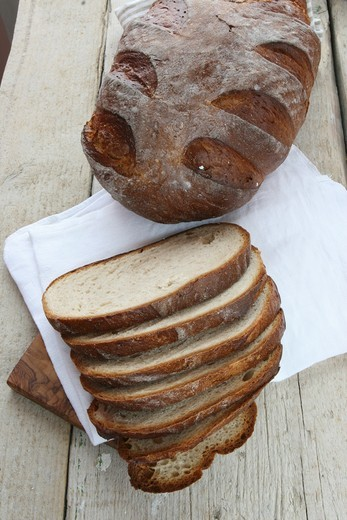 Stock Photo: 1532R-64767 Rustic bread baked in a wood-fired oven, whole loaf and sliced