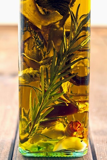 Porcini mushroom oil with herbs and rosemary : Stock Photo