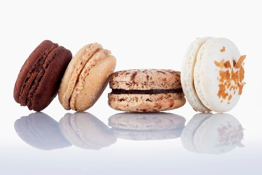Four different macaroons : Stock Photo