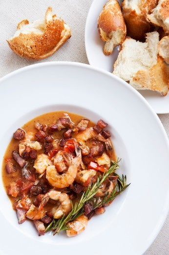 Shrimp and Pancetta Starter with Torn Crusty White Bread : Stock Photo