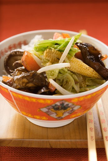 Vegetables and mushrooms cooked in wok on rice (China) : Stock Photo