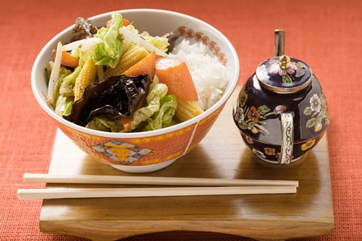 Stock Photo: 1532R-8784 Vegetables and mushrooms cooked in wok on rice (China)