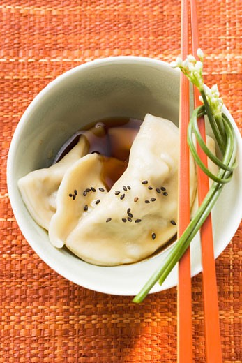 Wontons with soy sauce : Stock Photo