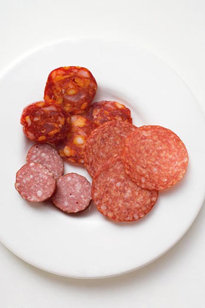 Italian paprika salami, Cabanossi and boiled salami : Stock Photo