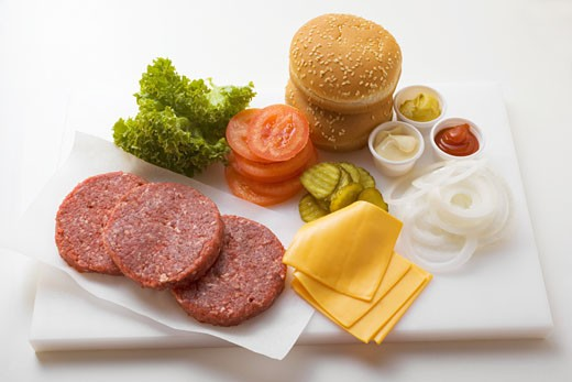 Stock Photo: 1532R-9564 Ingredients for cheeseburgers on chopping board