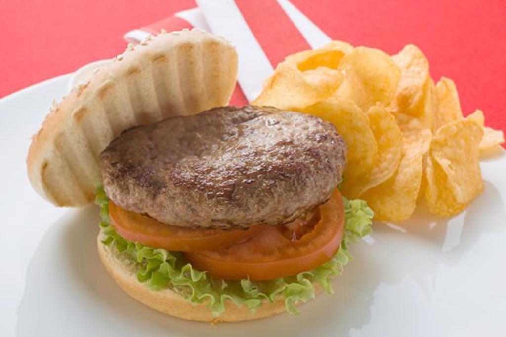 Hamburger with potato crisps : Stock Photo