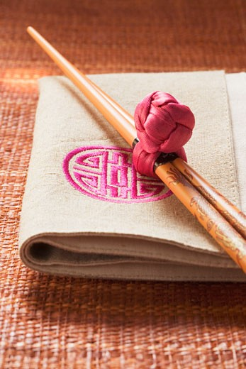 Chopsticks on fabric napkin (Asia) : Stock Photo
