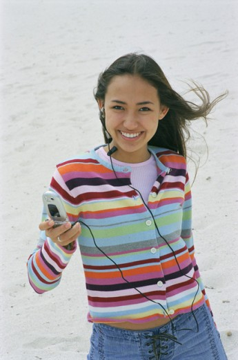 Stock Photo: 1534-124A Portrait of a teenage girl using a mobile phone