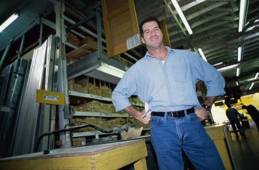 Portrait of a man standing in a lumber plant : Stock Photo