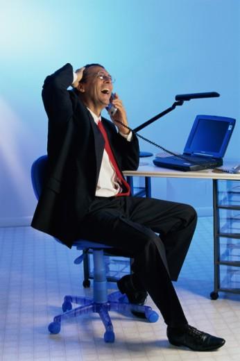 Businessman using a telephone : Stock Photo