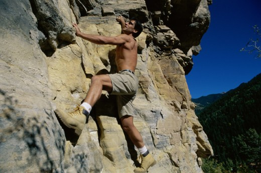 Side profile of a rock climber : Stock Photo